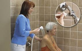 Caregiver assisting woman with shower|How to help our senior parents to be clean