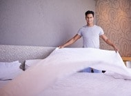 Man making bed|Cleaning, Caring, and Maintaining a Healthy Environment