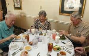 Family eating at the table How To Feeding Your Loved Ones