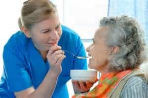 Caregiver feeding patient|How To Feeding Your Loved Ones