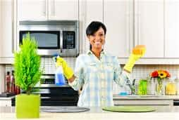 Woman cleaning kitchen|Caregiving Tips on Germs and Infection