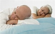 Man and woman trying to sleep|The Ultimate Cheat Sheet on Sleeping Problems