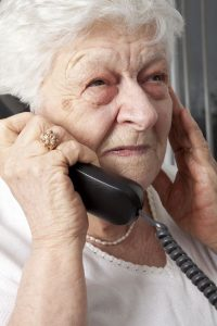 Elderly woman on the phone|How To Be A Family Caregiver For Your Loved One Long Distance