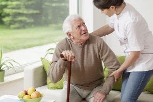 Caregiver with male patient|How to Give Your Senior Parent TLC After a Stroke