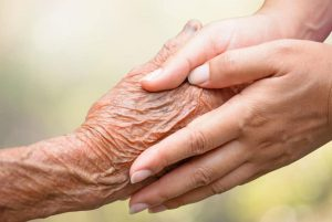 Senior and young holding hands|How I Found My Passion For Caregiving