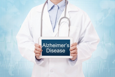 Doctor holding an Alzheimer's sign|How To Understand The Different Stages Of Alzheimer's