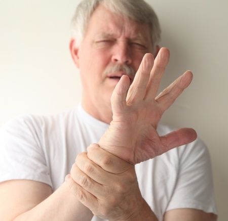Man with severe Neuropathy in hands|How To Cope With Neuropathy in Caring For Your Loved One
