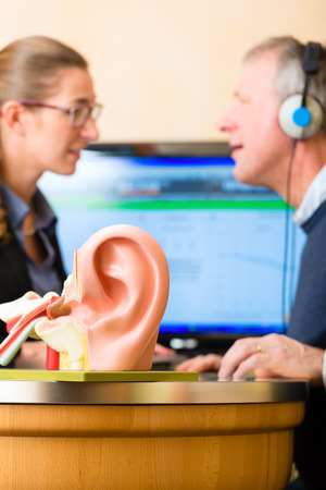 Man with audiologist|How To Care For Your Loved One With Hearing Loss