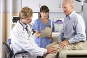 Man talking to doctor about his knee|How to help our loved ones who have undergone knee surgery