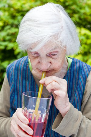 Woman drinking cranberry juice|