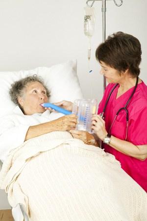 Pneumonia patient receiving respiratory therapy