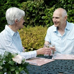 Dehydration|Senior couple holding glasses of water